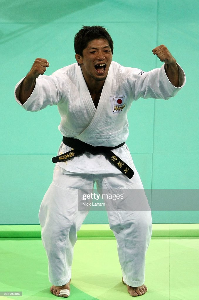 Masato Uchishiba of Japan celebrates after winning the gold medal against Benjamin Darbelet of France in the Men's -66 kg final during day 2 of the Beijing 2008 Olympic Games at the University of Science and Technology Beijing Gymnasium on August 10, 2008 in Beijing, China.