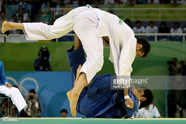 Masato Uchishiba of Japan throws Arash Miresmaeili of Iran in their 66 kg men's preliminary judo event held during day 2 of the Beijing 2008 Olympic...