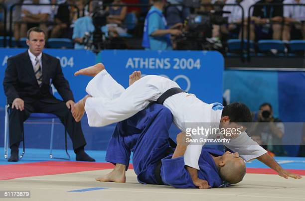Masato Uchishiba of Japan topples Jozef Krnac of Slovakia in the men's judo -66 kg class gold medal contest on August 15, 2004 during the Athens 2004...