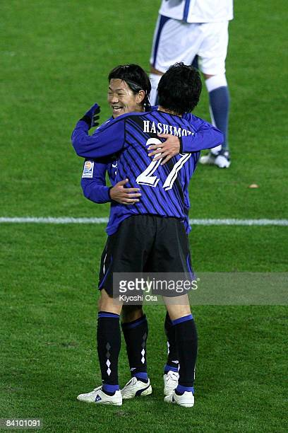 Masato Yamazaki and Hideo Hashimoto of Gamba Osaka celebrate their victory during the FIFA Club World Cup Japan 2008 third place match between...