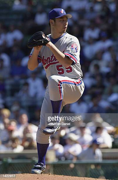 Masato Yoshii of the Montreal Expos winds back to pitch during the game against the Chicago Cubs on September 11 2002 at Wrigley Field in Chicago IL...
