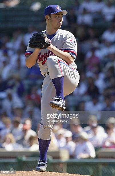 Masato Yoshii of the Montreal Expos winds up to pitch the ball during the game against the Chicago Cubs on September 11 2002 at Wrigley Field in...