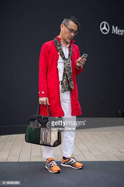 Masatomo Naka attends the Seiji Inoue show during Tokyo Fashion Week wearing Salomon shoes Gap pants and Manual Alphabet jacket scarf and shirtÊon...