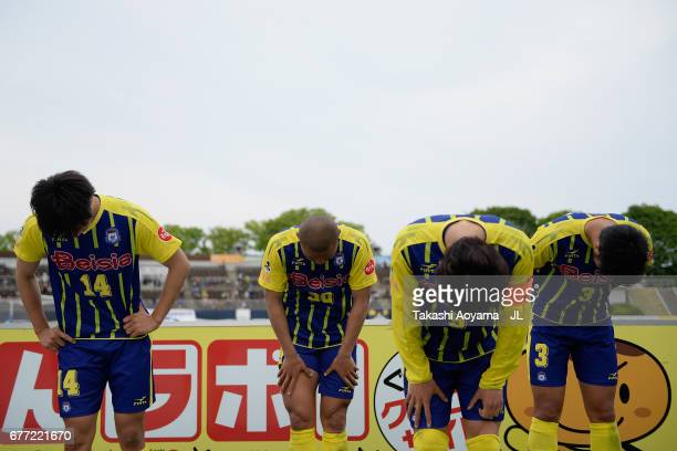 Masatoshi Ishida Yuki Matsushita Yuya Yamagishi and Yusuke Kawagishi of Thespa Kusatsu Gunma bow for apology after their 02 defeat in the JLeague J2...