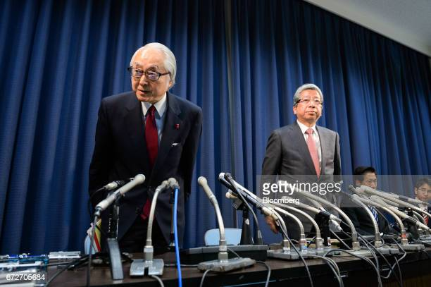 Masatsugu Nagato president and chief executive officer of Japan Post Holdings Co left and Kunio Yokoyama president and chief executive officer of...