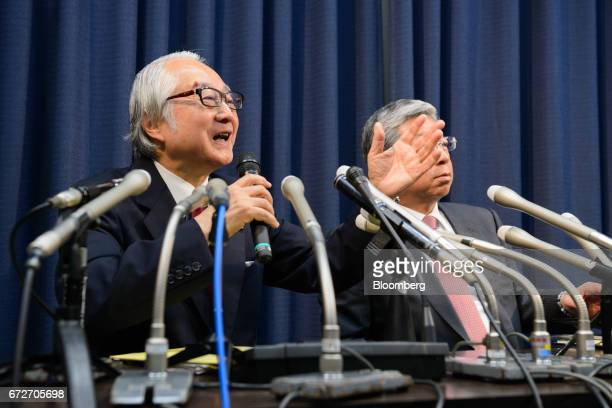 Masatsugu Nagato president and chief executive officer of Japan Post Holdings Co left speaks as Kunio Yokoyama president and chief executive officer...