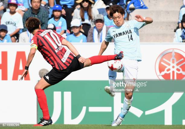 Masaya Matsumoto of Jubilo Iwata and Hiroki Miyazawa of Consadole Sapporo compete for the ball during the JLeague J1 match between Jubilo Iwata and...