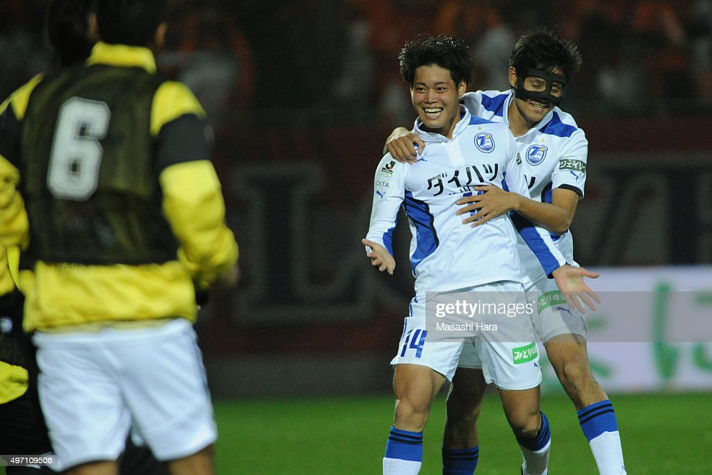 Masaya Matsumoto #14 of Oita Trinita celebrates the first goal during the J.League second division match between Omiya Ardija and Oita Trinita.Omiya won the promotion to the J1 next season.At the Nack 5 Stadium Omiya on November 14, 2015 in Saitama, Tokyo, Japan.