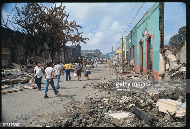 Looters make their way past rubble of Masaya marketplace in wake of fighting between troops and rebels fighting to bring down government of President...