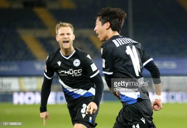 Masaya Okugawa of Arminia Bielefeld celebrates after scoring their team's first goal during the Bundesliga match between DSC Arminia Bielefeld and...