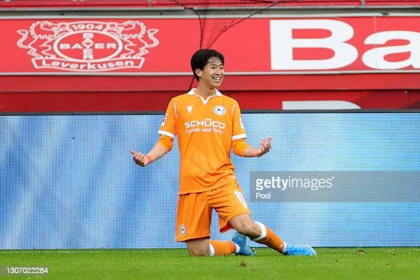 Masaya Okugawa of DSC Arminia Bielefeld celebrates after scoring their side's second goal during the Bundesliga match between Bayer 04 Leverkusen and...