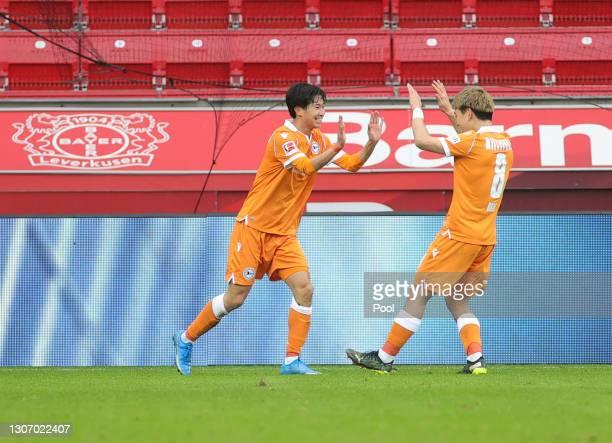 Masaya Okugawa of DSC Arminia Bielefeld celebrates with team mate Ritsu Doan after scoring their side's second goal during the Bundesliga match...