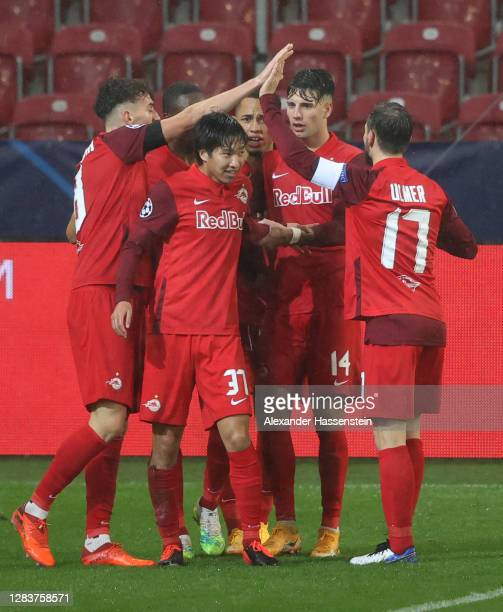 Masaya Okugawa of RB Salzburg celebrates after scoring his sides second goal during the UEFA Champions League Group A stage match between RB Salzburg...