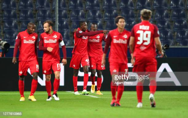 Masaya Okugawa of RB Salzburg celebrates after scoring his team's first goal during the UEFA Champions League Play-Off second leg match between RB...