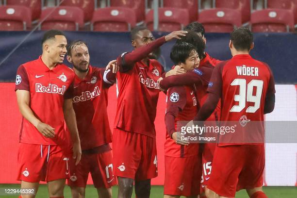 Masaya Okugawa of Red Bull Salzburg celebrates after scoring his team's second goal during the UEFA Champions League Group A stage match between RB...