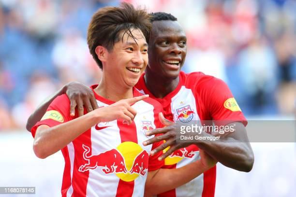 Masaya Okugawa of Salzburg celebrates with his teammate Patson Daka of Salzburg after scoring during the tipico Bundesliga match between FC Red Bull...
