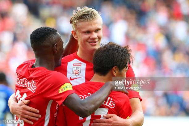 Masaya Okugawa of Salzburg celebrates with his teammates Patson Daka and Erling Haaland of Salzburg after scoring during the tipico Bundesliga match...