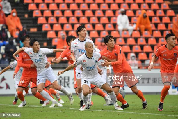 Masaya TASHIRO of Tochigi SC and Akira TOSHIMA of Omiya Ardija battle for the ball during the J.League Meiji Yasuda J2 match between Omiya Ardija and...
