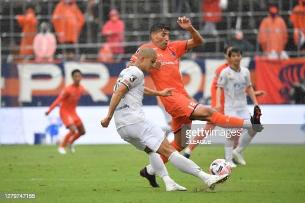 Masaya TASHIRO of Tochigi SC and IBBA of Omiya Ardija battle for the ball during the J.League Meiji Yasuda J2 match between Omiya Ardija and Tochigi...