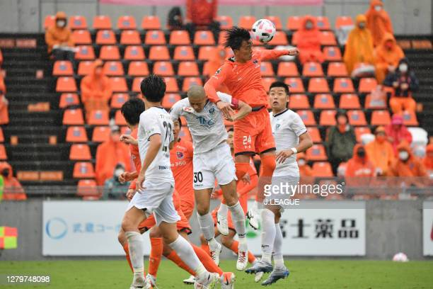 Masaya TASHIRO of Tochigi SC and Keisuke NISHIMURA of Omiya Ardija battle for the ball during the J.League Meiji Yasuda J2 match between Omiya Ardija...