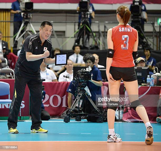 Masayoshi Manabe Head coach of Japan directs his player Saori Kimura during day four of the FIVB World Grand Prix Sapporo 2013 match between Japan...