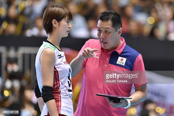 Masayoshi Manabe head coach of Japan speaks to Saori Kimura of Japan in the match between Japan and Kenya during the FIVB Women's Volleyball World...