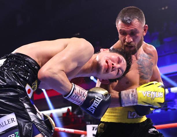 Masayoshi Nakatani and Vasiliy Lomachenko exchange punches during their fight at Virgin Hotels Las Vegas on June 26, 2021 in Las Vegas, Nevada.
