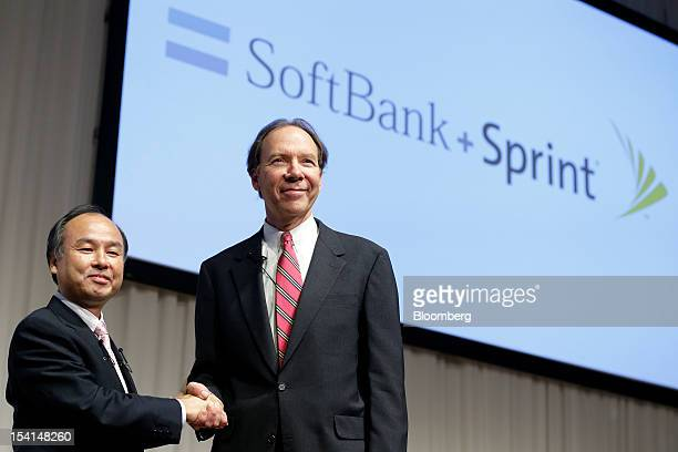 Masayoshi Son chairman and chief executive officer of Softbank Corp left shakes hands with Dan Hesse president and chief executive officer of Sprint...
