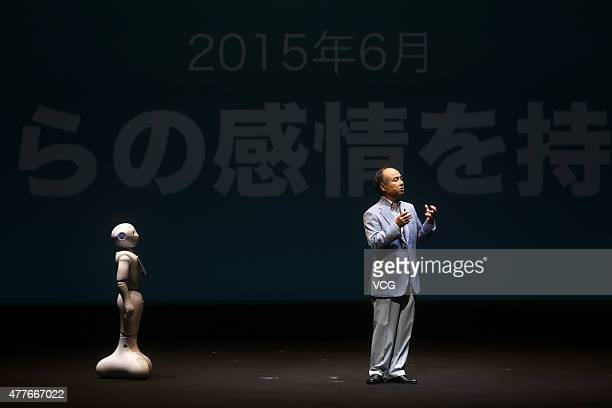 Masayoshi Son chairman and chief executive officer of SoftBank Corp introduces 'Pepper' the world's first personal robot made by Softbank during a...