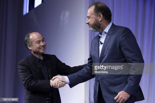 Masayoshi Son chairman and chief executive officer of SoftBank Group Corp left shakes hands with Daniel Ammann president of General Motors Co at the...