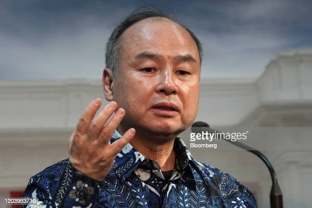 Masayoshi Son, chairman and chief executive officer of SoftBank Group Corp., speaks during a news conference following a meeting with Joko Widodo,...