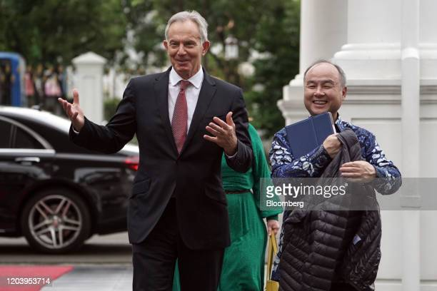 Masayoshi Son chairman and chief executive officer of SoftBank Group Corp right and Tony Blair UK's former prime minster arrive for a meeting with...