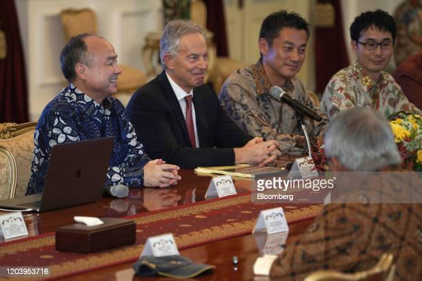 Masayoshi Son chairman and chief executive officer of SoftBank Group Corp left and Tony Blair UK's former prime minster listen during a meeting with...