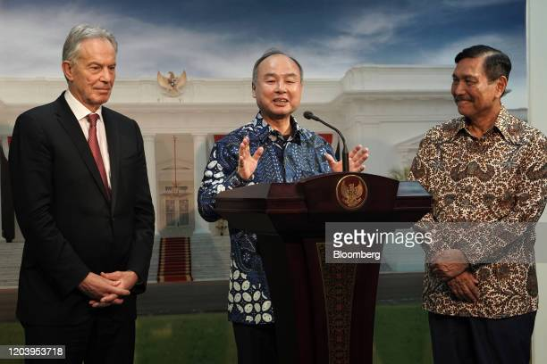 Masayoshi Son chairman and chief executive officer of SoftBank Group Corp center speaks alongside Tony Blair UK's former prime minster left and Luhut...