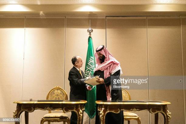 Masayoshi Son chairman and chief executive officer of SoftBank Group Corp left shakes hands with Mohammed bin Salman Saudi Arabia's crown prince...