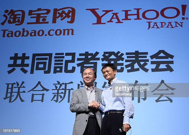 Masayoshi Son president and chief executive officer of SoftBank Corp and chairman of Yahoo Japan Corp left and Jack Ma chairman and chief executive...