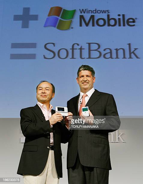 Masayoshi Son president of Japan's mobile operator Softbank and Microsoft president Darren Huston introduce new cell phones equipped with Windows...