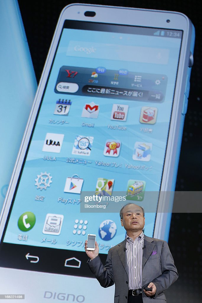 Masayoshi Son, president of SoftBank Corp., introduces the company's Digno R 202K smartphone, manufactured by Kyocera Corp., during a product launch in Tokyo, Japan, on Tuesday, May 7, 2013. Son will visit the U.S. to meet with Sprint Nextel Corp. institutional investors to discuss the company's proposed takeover, SoftBank spokesman Mitsuhiro Kurano said today. Photographer: Kiyoshi Ota/Bloomberg via Getty Images