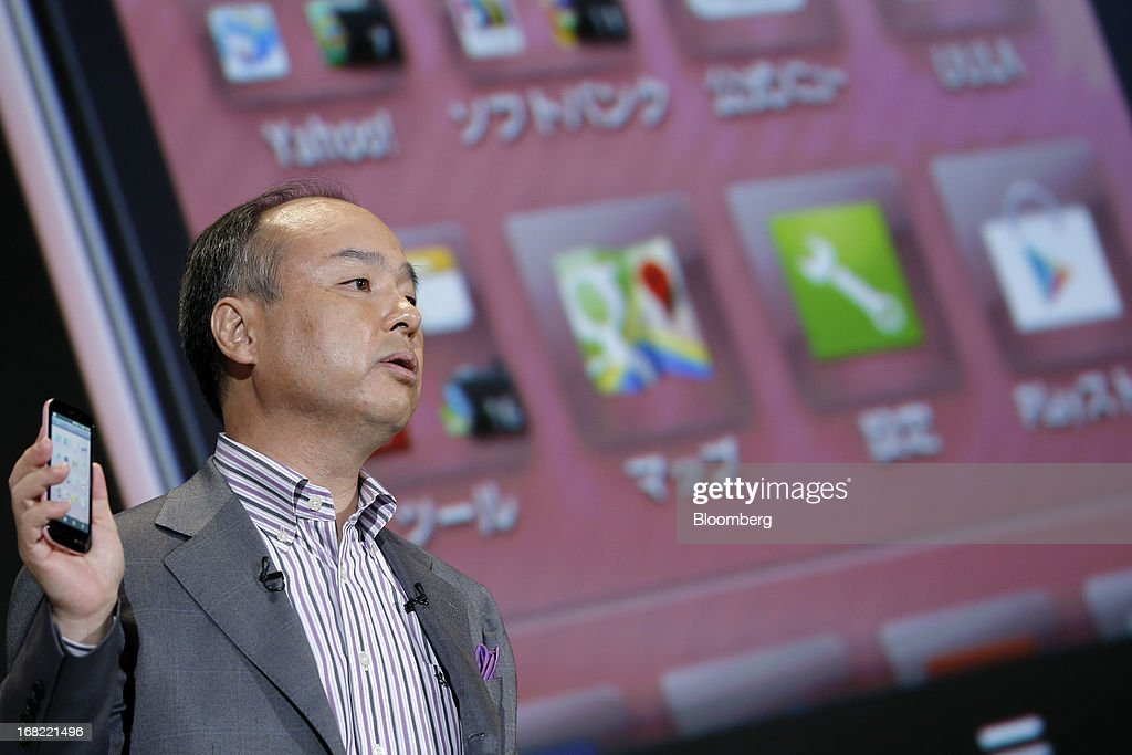 Masayoshi Son, president of SoftBank Corp., introduces the company's Aquos Phone SS 205SH smartphone, manufactured by Sharp Corp., during a product launch in Tokyo, Japan, on Tuesday, May 7, 2013. Son will visit the U.S. to meet with Sprint Nextel Corp. institutional investors to discuss the company's proposed takeover, SoftBank spokesman Mitsuhiro Kurano said today. Photographer: Kiyoshi Ota/Bloomberg via Getty Images