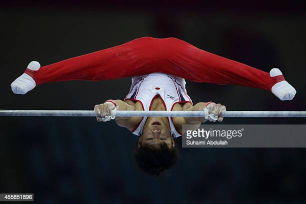 Masayoshi Yamamoto of Japan competes in the horizontal bar of the men's qualification and team final during the 2014 Asian Games at Namdong Gymnasium...