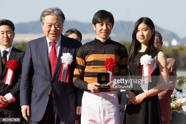 Masayuki Goto President and CEO of Japan Racing Association Yutaka Take jockey of Kitasan Black and Tao Tsuchiya at the presentation ceremony after...