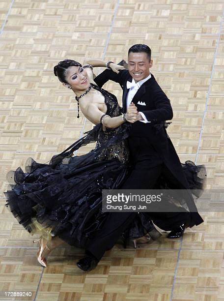 Masayuki Ishihara and partner Saori Ito of Japan compete in the Dancesport Standard Five Dances Waltz Final at Samsan World Gymnasium during day...