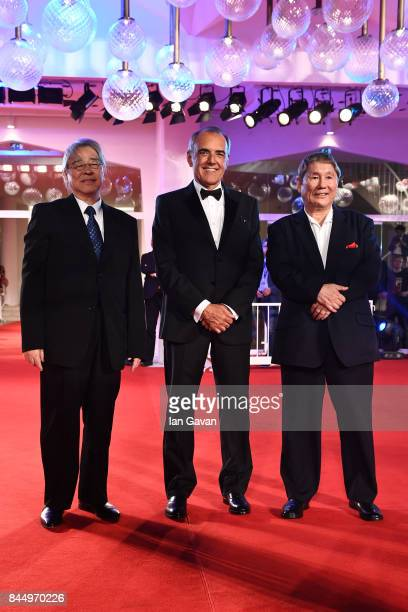 Masayuki Mori Festival director Alberto Barbera and Takeshi Kitano walk the red carpet ahead of the 'Outrage Coda' screening during the closing night...