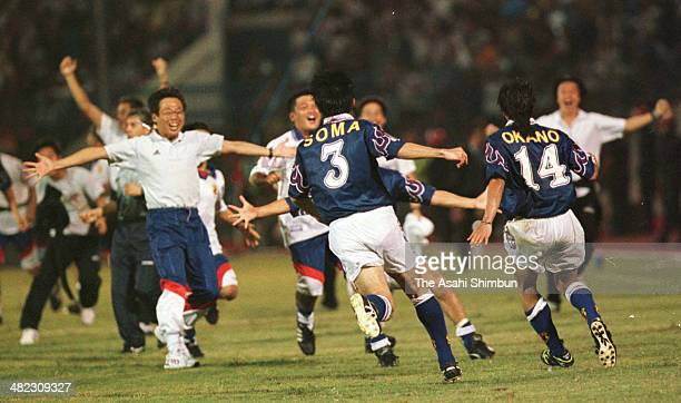 Masayuki Okano of Japan celebrates scoring his team's second and the golden goal with his teammates and staffs during the France World Cup Asian...