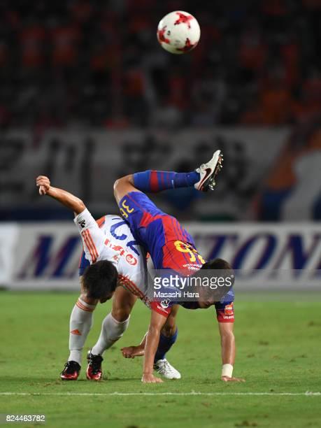 Masayuki Yamada of FC Tokyo and Atsushi Kawata of Albirex Niigata compete for the ball during the JLeague J1 match between FC Tokyo and Albirex...