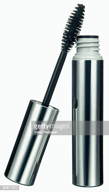 Mascara and brush eye makeup in silver tube