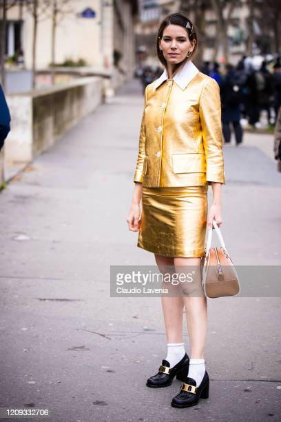 Mascarada Paris, wearing a gold jacket with matching mini skirt, black loafers and brown Prada bag, is seen outside Mugler, during Paris Fashion Week...