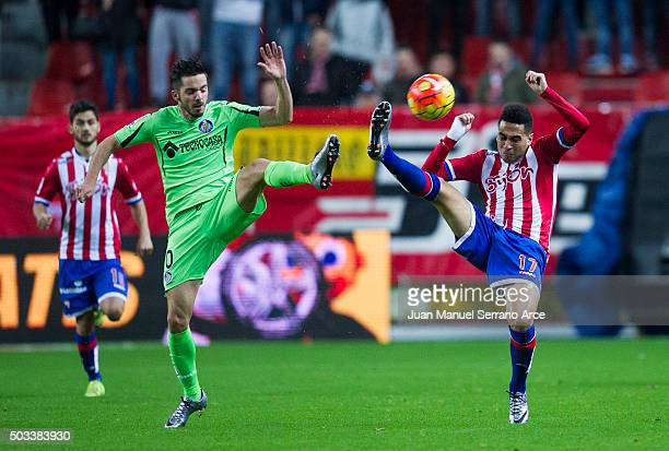 Mascarell of Real Sporting de Gijon duels for the ball with Pablo Sarabia of Getafe CF during the La Liga match between Real Sporting de Gijon and...
