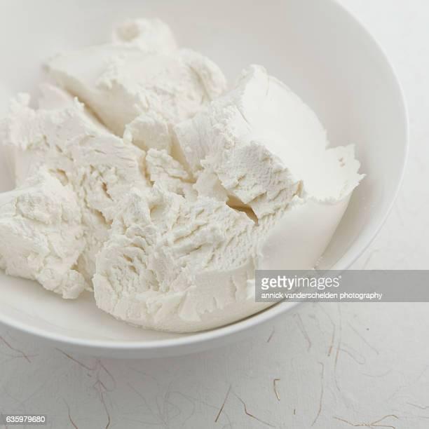 Mascarpone in white bowl.
