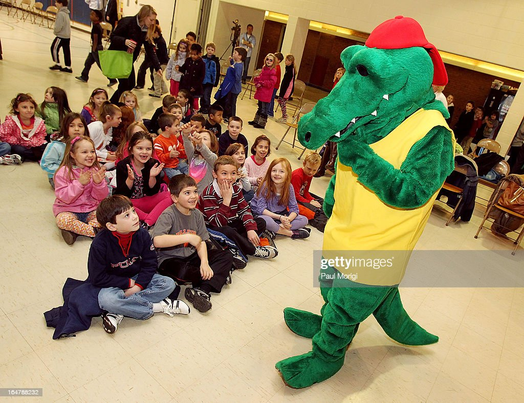 Mascot Al E. Gator excites students at a school assembly to celebrate the Scott Shared Values Sweepstakes award of $25,000 to Youth's Benefit Elementary School on March 28, 2013 in Fallston, Maryland.